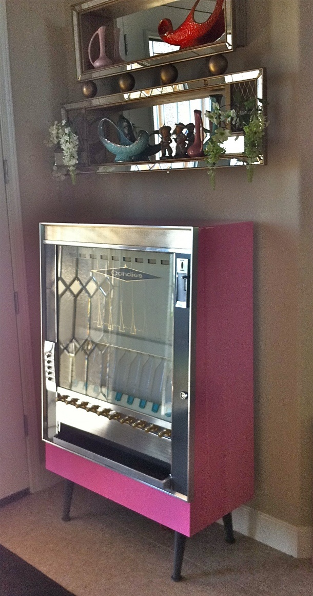 Pink vintage cigarette vending machine.I love the mirrored shelves. Totally can DIY this!