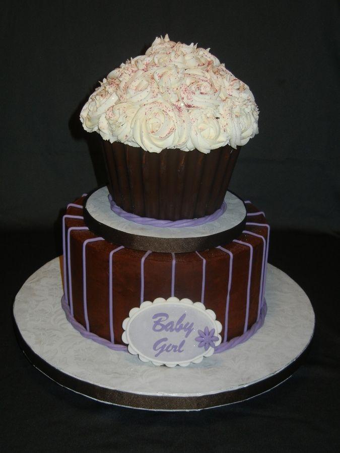 Chocolate fudge cake, candy shell on cupcake.