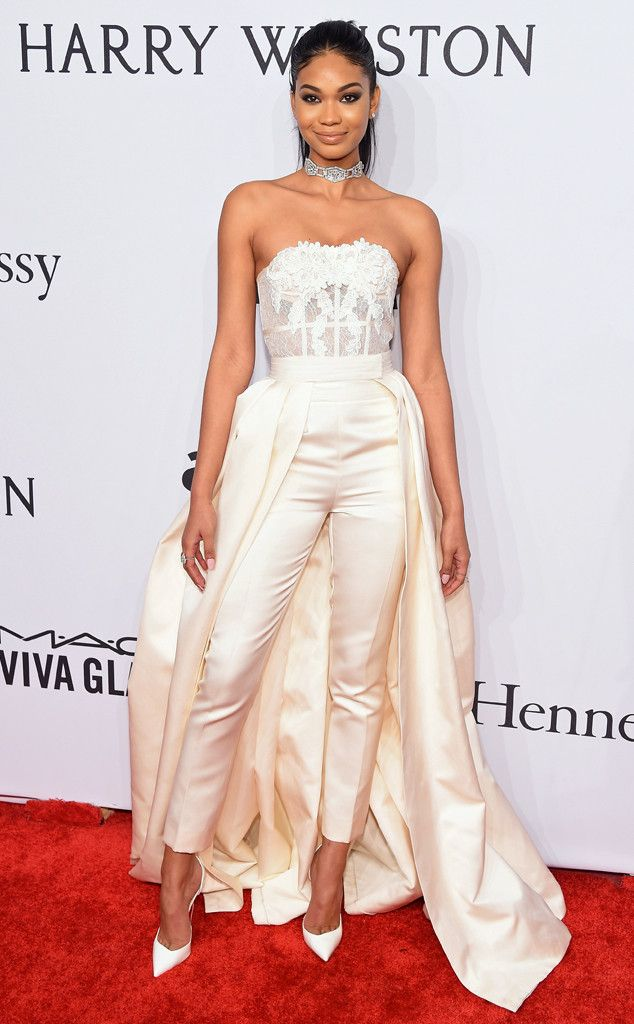 Chanel Iman from amfAR Gala 2016 Red Carpet Arrivals  The dark-haired beauty popped on the red carpet in a cream lace-embellished strapless jumpsuit with an attached train.