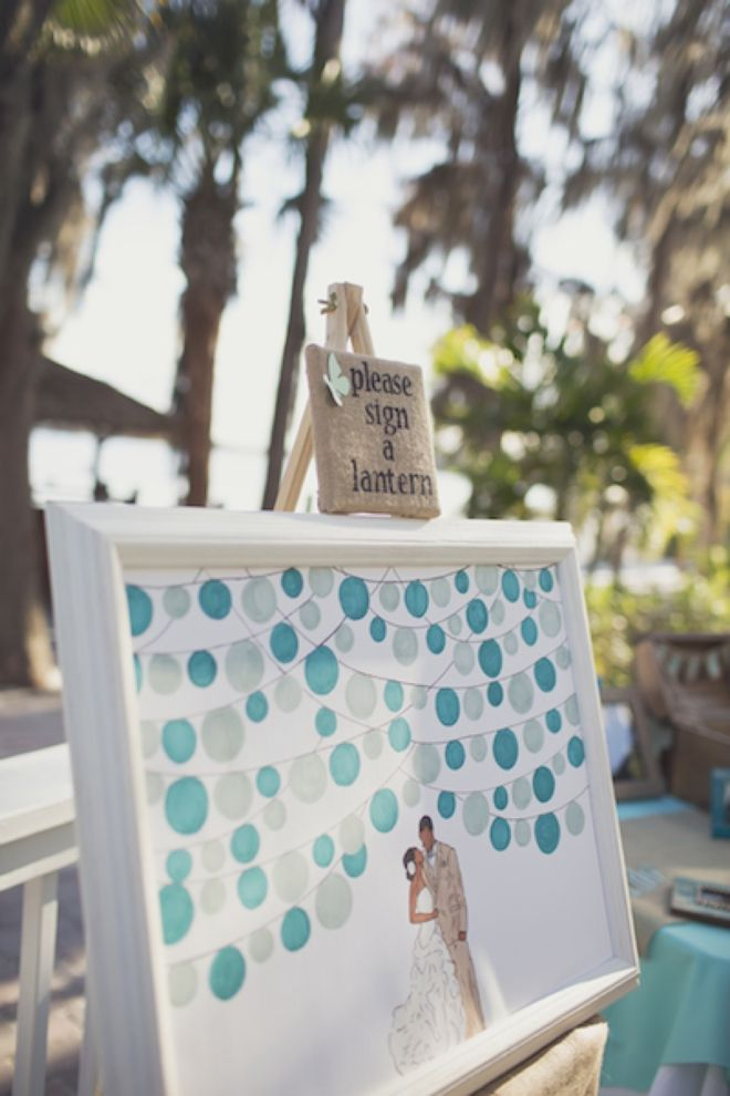 We are obsessed with this guest book! The bride painted this canvas and asked each of her guests to sign a lantern! Image: Anchor and Ivory Photography