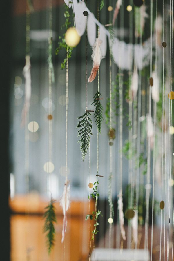 leaf, gold disc, and feather backdrop, photo by Shari + Mike Photographers http://ruffledblog.com/black-rock-resort-wedding #weddingideas #garlands