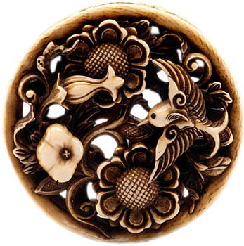 NETSUKE -Ishikawa Rensai carved this ivory and inlaid piece depicting lotus blossoms and a bird in the mid-to-late 19th century.