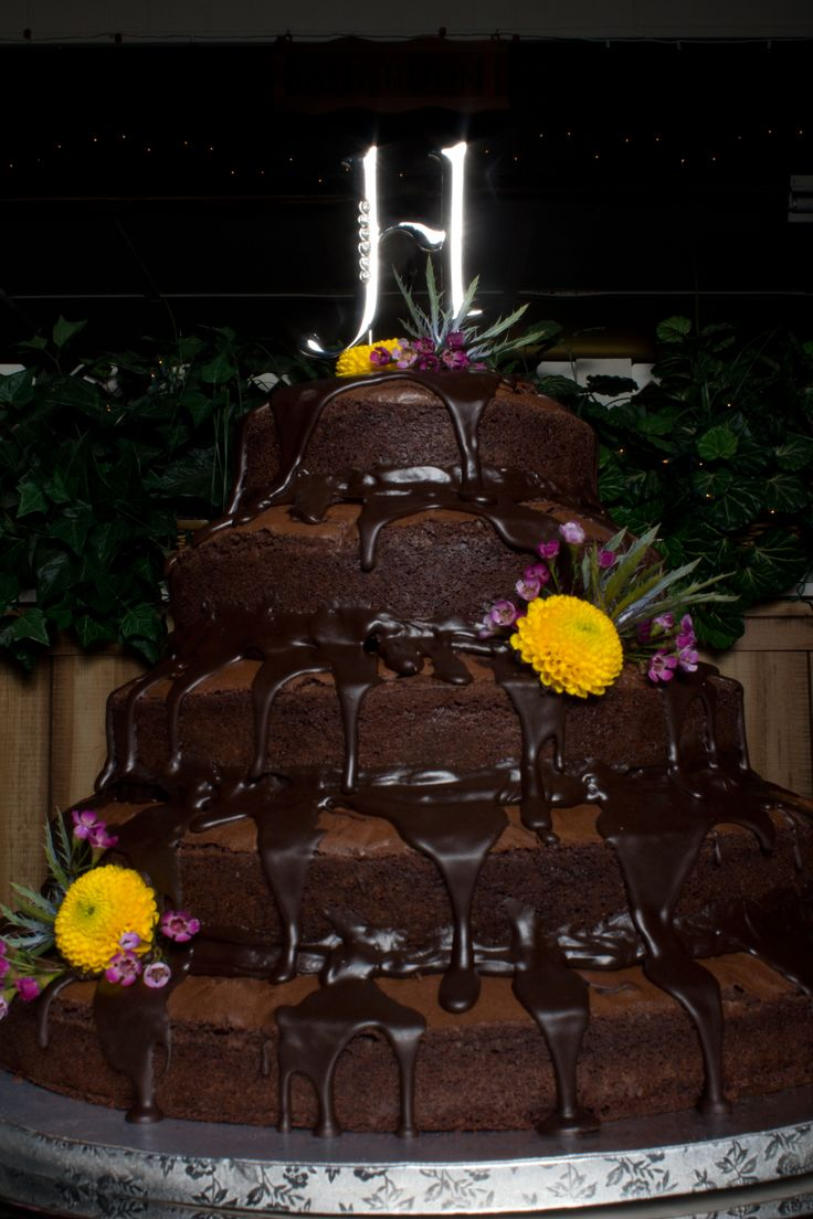 No Cake at this Wedding!!! Brownies were the center of the cake table and were served along with cheese cake instead of the traditional wedding cake.