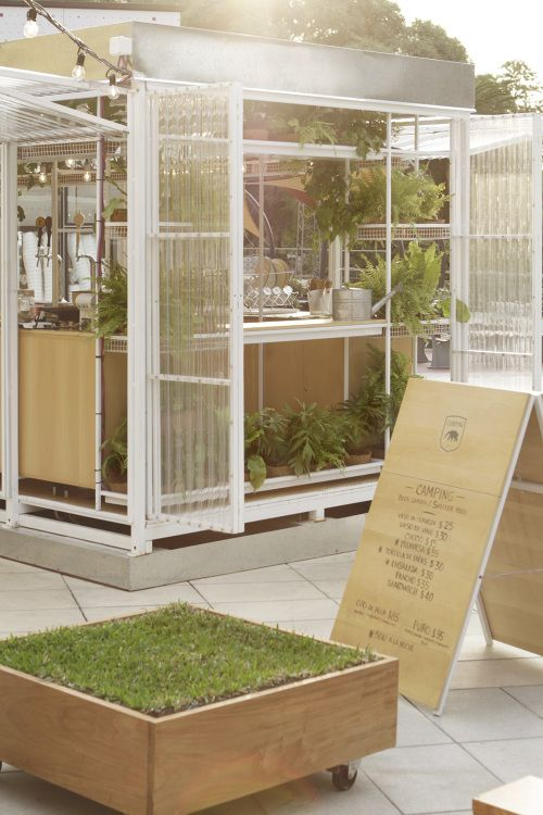 "Located in the rooftop of Buenos Design center (Recoleta). This ""pop-up box"", called the ""Camping's shelter "", works with the green  and nature that surround it. The translucent  facade and the thin white metal structure,   was designed to fold itself  and open entirely, working  as a light  filter that contains plants and all the functions for the store. During the night, this space look like a lantern in the rooftop, transparent, lighting and green ."