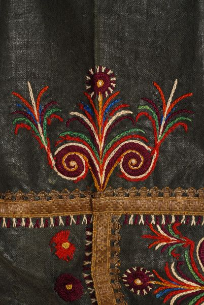 Detail of the embroidered decoration at the upper part of the arm, at the sleeve panel
