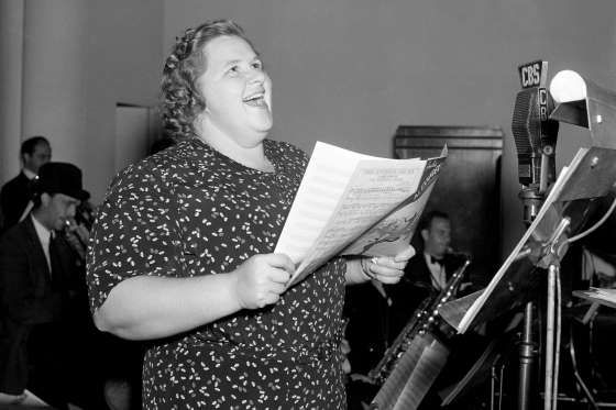 """1939: KATE SMITH RECORDS 'GOD BLESS AMERICA' The """"First Lady of Radio"""" records the popular number """"God Bless America,"""" a patriotic song written by Irving Berlin."""