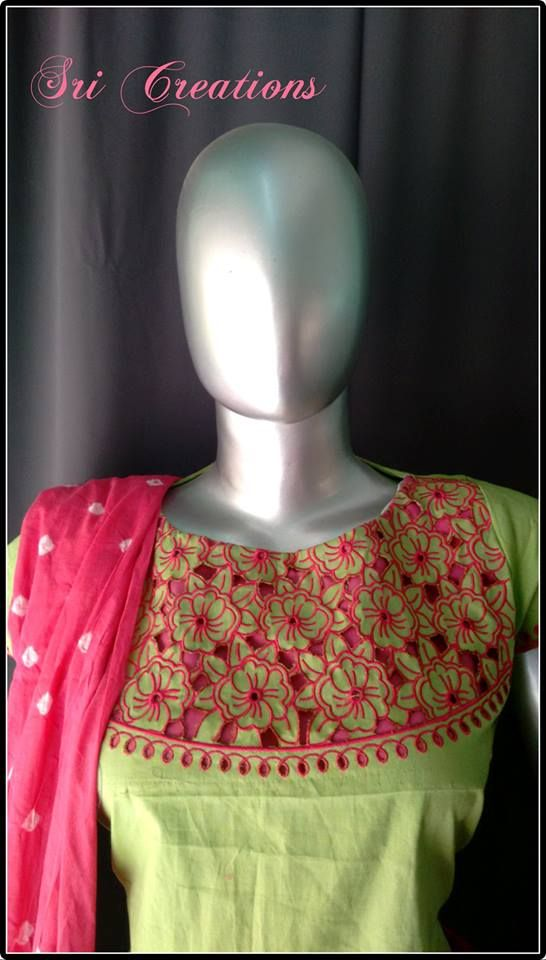 A cutwork embroidery with roses and boat neck