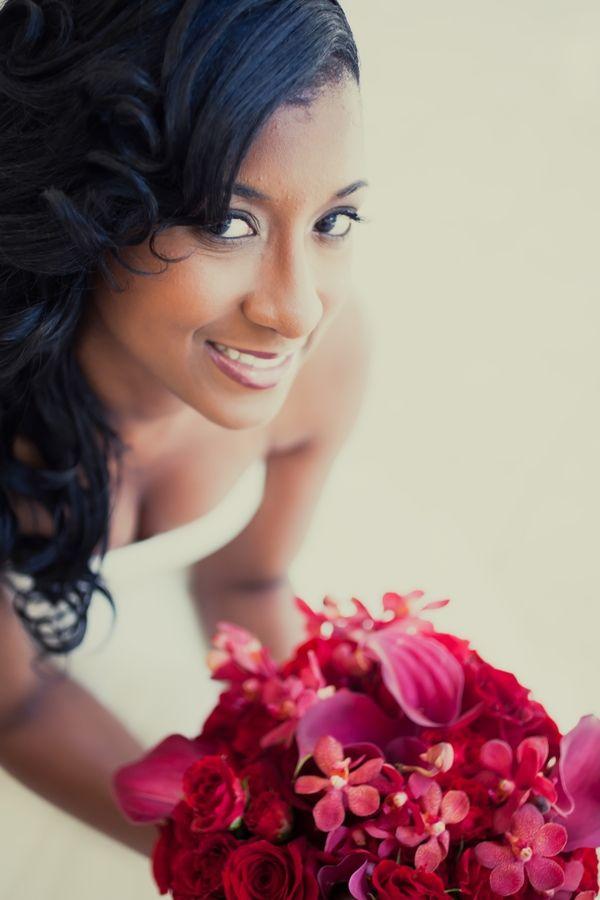 Jocelyn. Photo by Janet Howard Photography; black bride; bride of colour; fuchsia flower bouquet