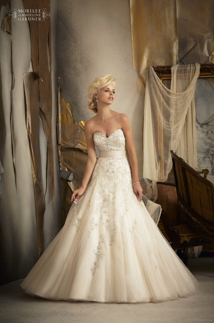 Mori Lee  #1909. For more information on these gowns and others that we carry in our store please call toll free 1-800-344-2672. Or visit thewinneroutlet.com