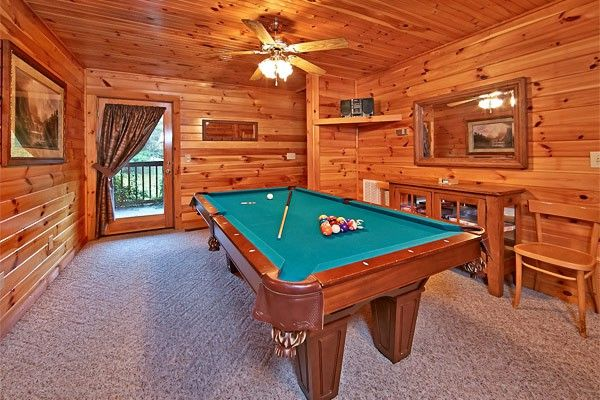 Don't Fence Me In -- The game room which separates the two bedrooms has a full size pool table, queen sofa sleeper, entry to the second private deck, television with DVD player and some boxed board games for family game night.