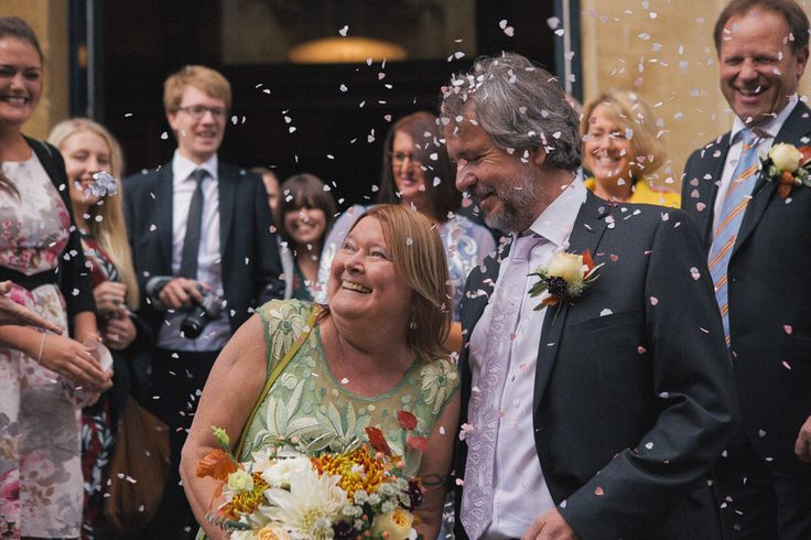 Happy confetti fun, moments after a Bristol registry office wedding ceremony