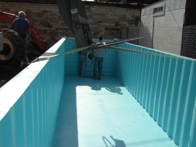 Construction of a storage container swimming pool.
