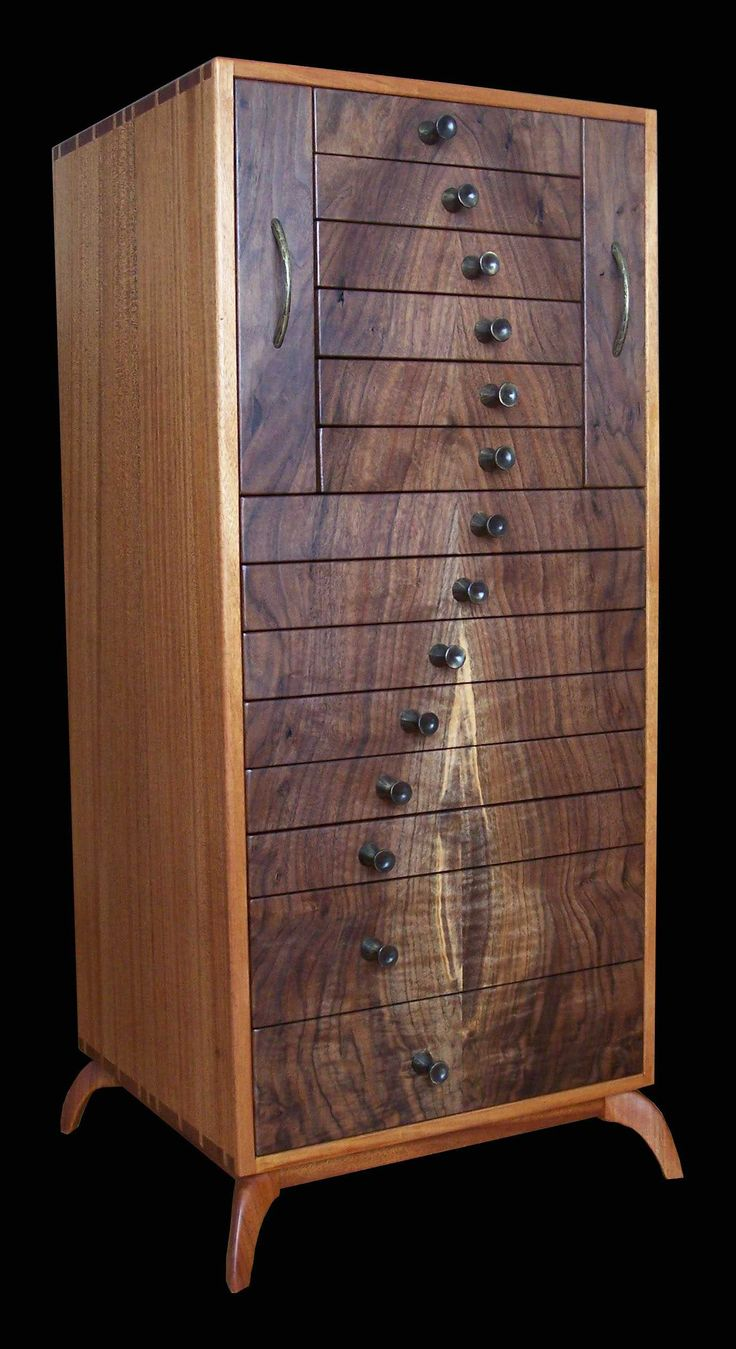 Pam's Cherry and quilted maple jewelry chest.  I would love to use this as a bed side table.