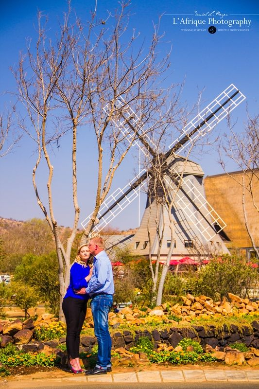 a gorgeous photo with the windmill in the background photo by Daniel L Meyer from L'Afrique Photography