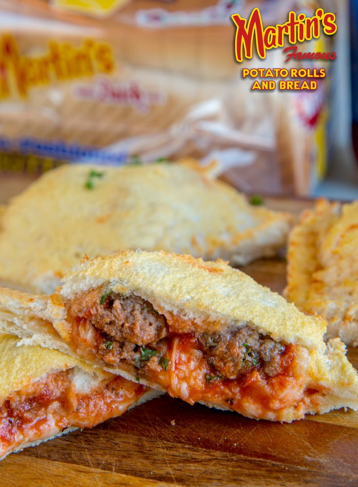 Meatball Marinara Pocket Sandwiches | These warm and comforting pocket sandwiches are filled with Italian-seasoned mini meatballs, marinara sauce, and mozzarella cheese, and stuffed between two slices of Martin's Old-Fashioned Real Butter Bread. For this method, remove the crusts from the bread, add the filling, then seal with a bit of egg wash and crimp the top and bottom slices with a fork.