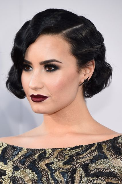 Last year, Lovato went full-on Moulin Rouge with a faux bob, jet-black eyes, and the sexiest vampy lip, ever. #refinery29 http://www.refinery29.com/2016/08/119343/demi-lovato-beauty-evolution#slide-13