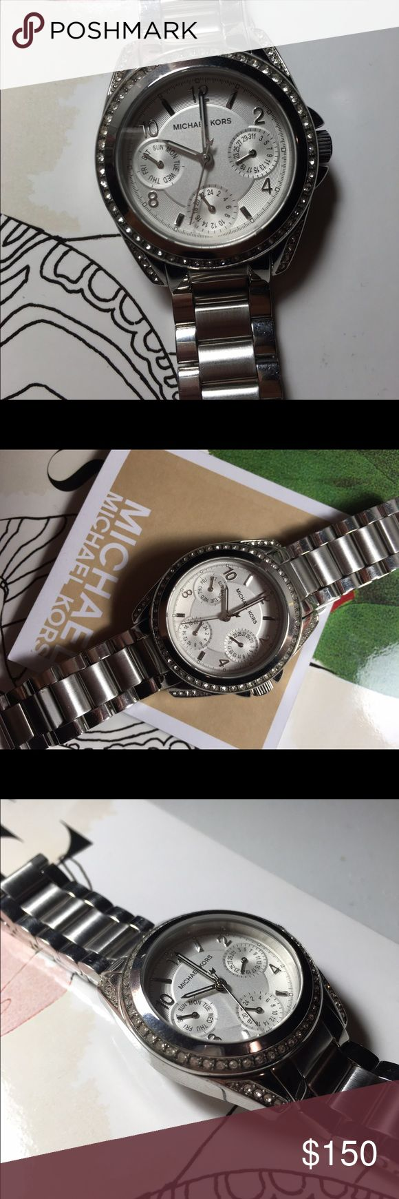 Michael Kors Silver Watch Never been worn Has a halo of diamonds tells what day and month it is Michael Kors Accessories Watches