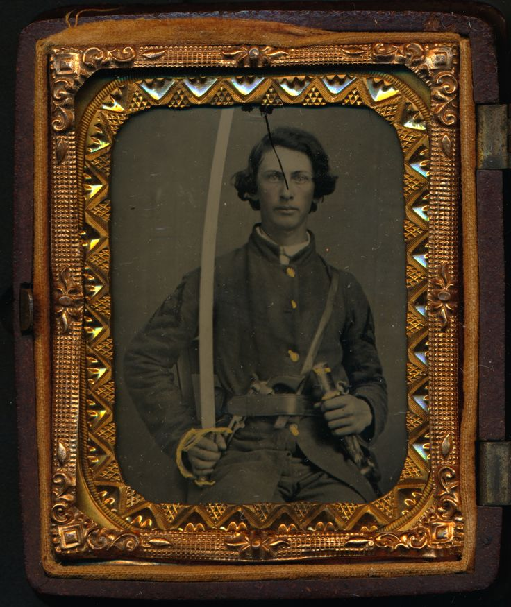 Ninth Plate Ambrotype of Sergeant James Monroe Edwards (1843-1911) of Company K, 4th and 12th Georgia Cavalry.  In the image he holds a cavalry saber in one hand and his scabbard in the other.  A revolver is tucked in his belt.  He has an interesting insignia on his sleeve that is different than a classic sergeant's chevrons.