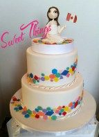 Canadian pride cake.  Custom cake topper of a cute Canadian girl with a Canada flag.  Sweet Things by Wendy  sweetthingsbywendy.ca