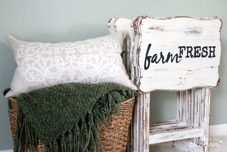 DIY:  How to Give New Life to Dated Furniture - inexpensive wood tv trays were given a farmhouse look with chalk paint and graphics. This post has the info, including how to create and transfer graphics onto furniture - via Character and Charm