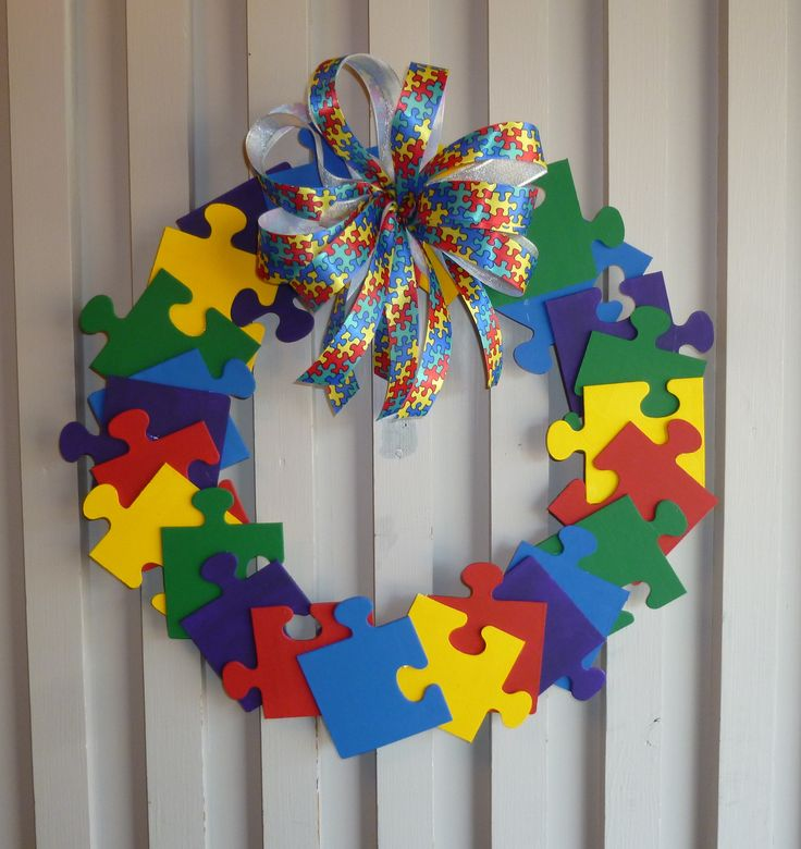 Autism Awareness Wreath- Painted wooden puzzle pieces purchased from Hobby Lobby hot-glued onto an embroidery hoop. Added matching Autism Ribbon bow. Love it!