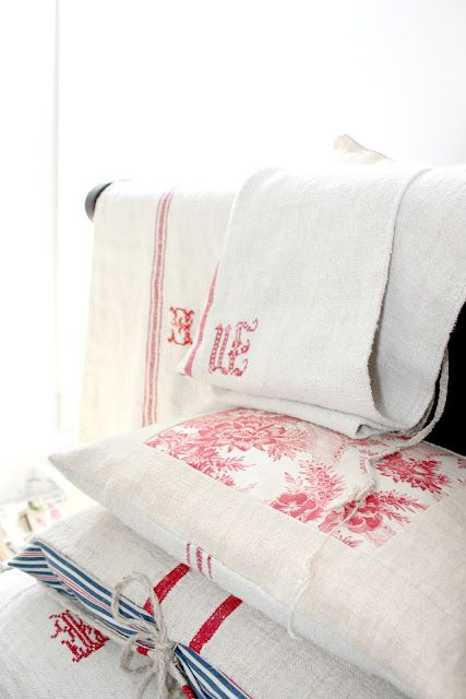 Maria from Rusty Hinge does such an amazing job of using vintage linen's in her home.. oh sigh i wish i could do that.