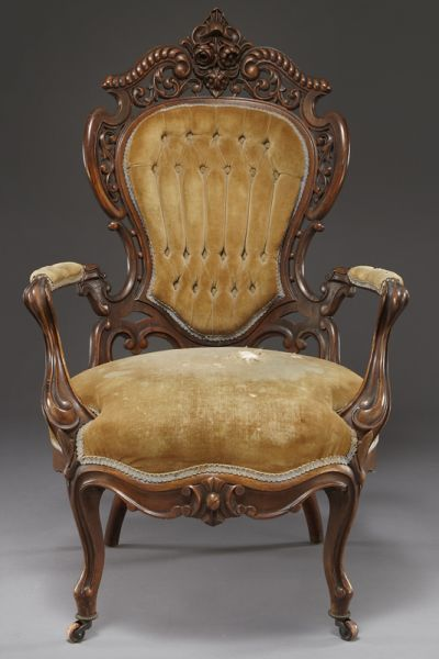 """*J MEEKS (STANTON HALL"""" PATTERN ARM CHAIR ~ rosewood, in the rococo Revival style, having an arched floral carved crest over an upholstered cartouche shaped back flanked by reticulated C.S. carved stiles, joined by shaped open arms, with carved serpentine seat rail, raised on cabriole legs and casters, c. 1850-1860."""