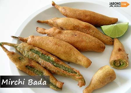 Hyderabadi style #MirchiBada is a common snack or appetizer, stuffed green chili fritters and is widely famous in this city. Though they are found with different stuffing at different regions in India but Hyderabadi style are the best one to have.