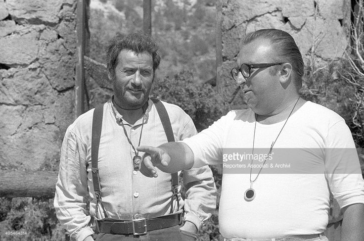 American actor Eli Wallach listening to Italian director Sergio Leone's directions on the set of the film The Good, the Bad and the Ugly. 1966