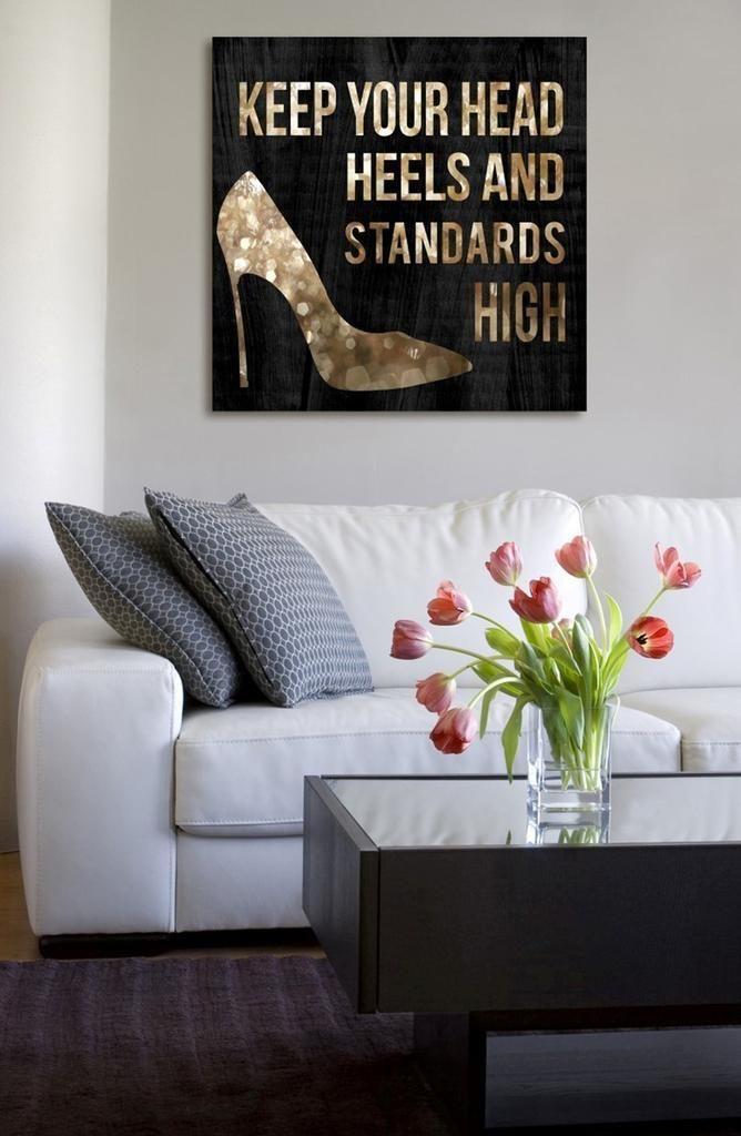 Keep your interior design standards high with chic wall art featuring an inspirational message. 'Head & Heels' Canvas Wall Art