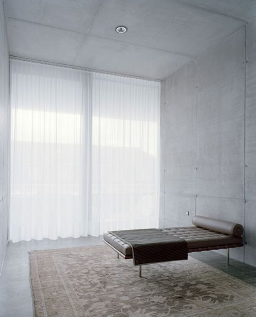"(BrandonRugs.com) Minimalism is saved from oppressive austerity in this ""meditation chamber"" by the use of the hand-knotted Pak-Agra (Peshawar) rug. As Freud's couch proved, REAL handmade oriental rugs are a wonderful base from which to commence journeys of inner exploration."