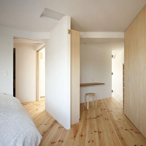 Japanese architect Hiroyuki Tanaka added diagonal walls and blue lights to this…