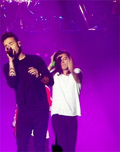 There's Liam singing his heart out and there's Harry doing... whatever he's doing