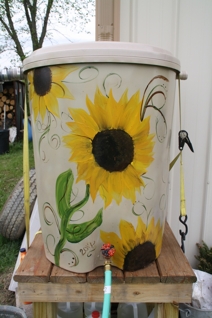 painted rain barrel, use a brown background.. have kids paint sunflowers on it..might be cute