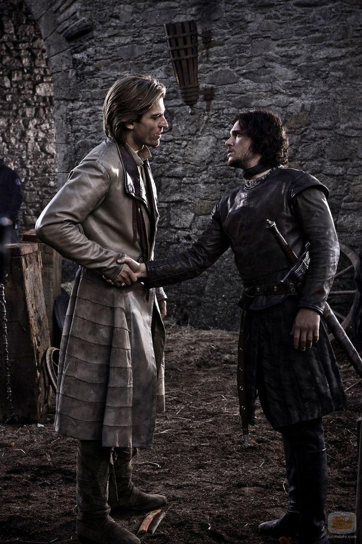 The Kingslayer grabbing the hand of Jon Snow.