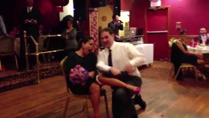 Crazy Gartner-Catcher Strips for Bouquet-Catcher!! You know things got real when the garter winner does a small striptease before placing the garter on the lady who won the bouquet. #funny #wedding #video #moment