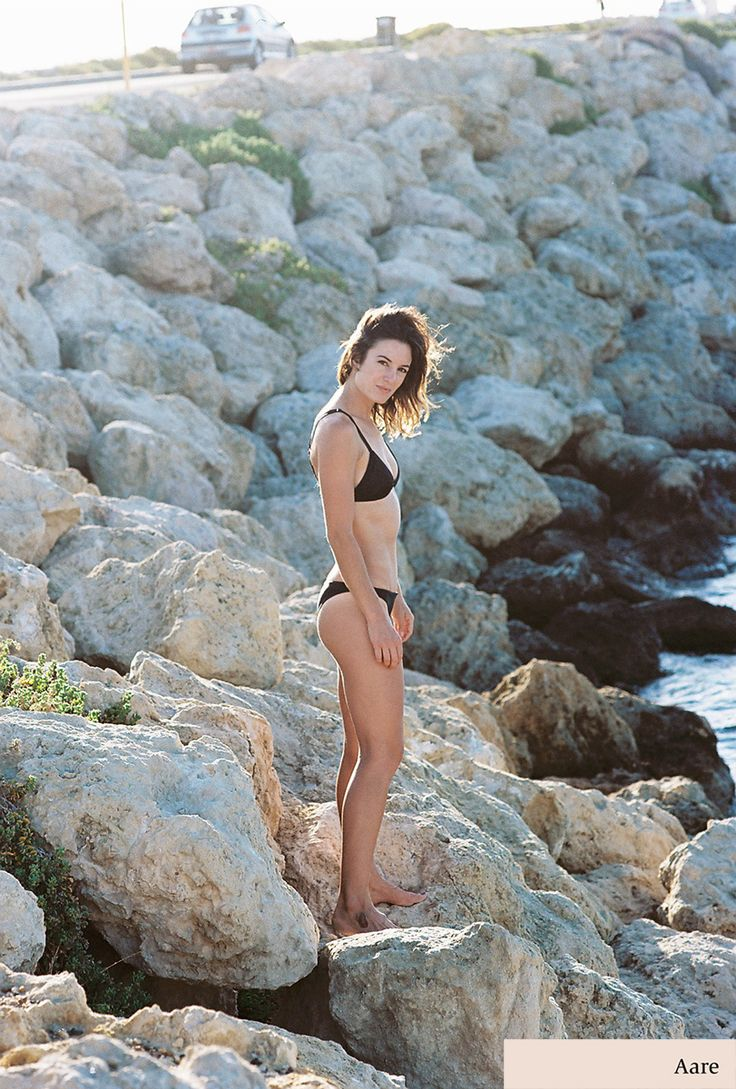 Hannah wearing the Aare Tamar top and Blyth bottoms in black. Available now - www.aareswim.com