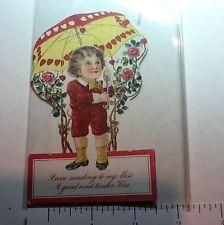 #B662- Vintage Valentine's Day Die Cut Greeting Card Boy Holding Fancy Umbrella
