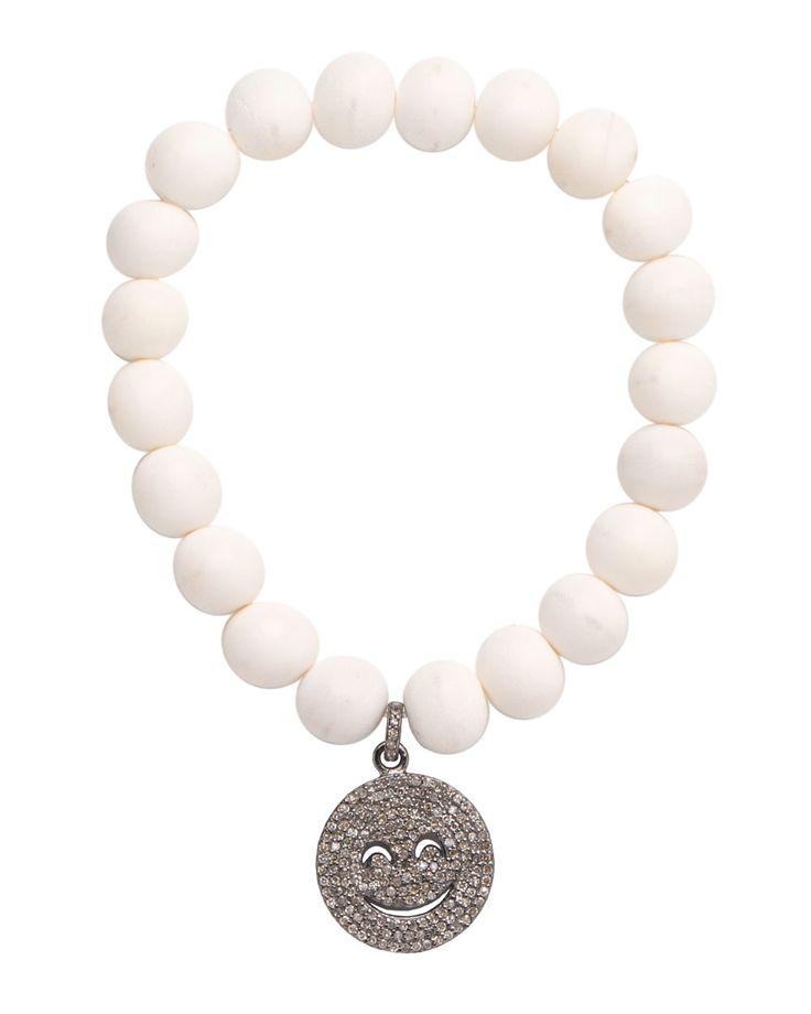 "Hannah Ferguson White BoneBead Bracelet with Diamond Emoji Charm White bone beaded stretch bracelet featuring a pave diamond smiley ""emoji"" charm Approx. 2.25"" interior diameter Slip-on style"