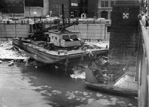 The Great St. Patrick's Day Flood of 1936. A barge resting under the 7th Street Bridge (Sun-Telegraph photo)