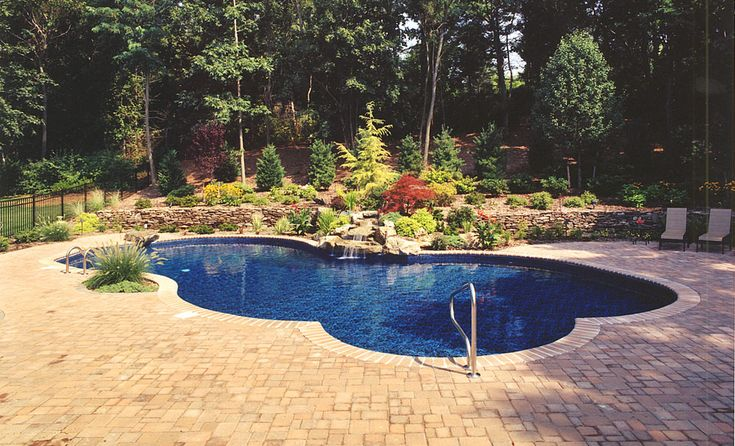 Nice landscaping around the pool area pools pool for Landscaping ideas for pool areas