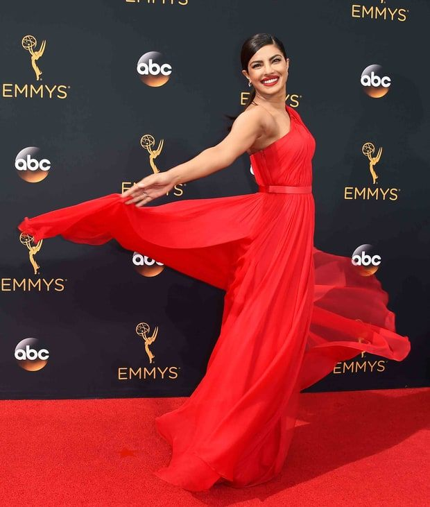 2016 Emmys: Priyanka Chopra in a flowing red one-shoulder Jason Wu gown paired with Brian Atwood heels