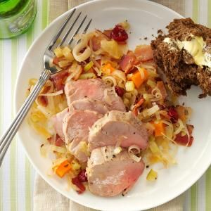 Pork Tenderloin with Cran-Apple Sauerkraut Recipe -I love all the ingredients in this recipe because together they're perfect for Oktoberfest, a fun festival during my favorite time of the year. Serve the pork and sauerkraut with a hearty dark bread, such as rye or pumpernickel, along with an ice-cold beer. Delicious!—Barbara Lento, Houston, Pennslvania