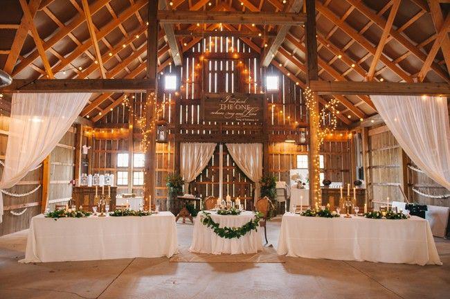 Barn reception tables with garland | Amanda Adams Photography | see more at…