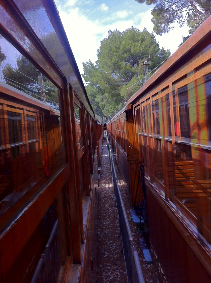 Here both of the historical wooden trains are passing each other, between Soller and Port of Soller. ----- More Information: http://www.nofrills-excursions.com/excursions-tours-thingstodo/port-alcudia/a-day-in-lluc-and-soller/