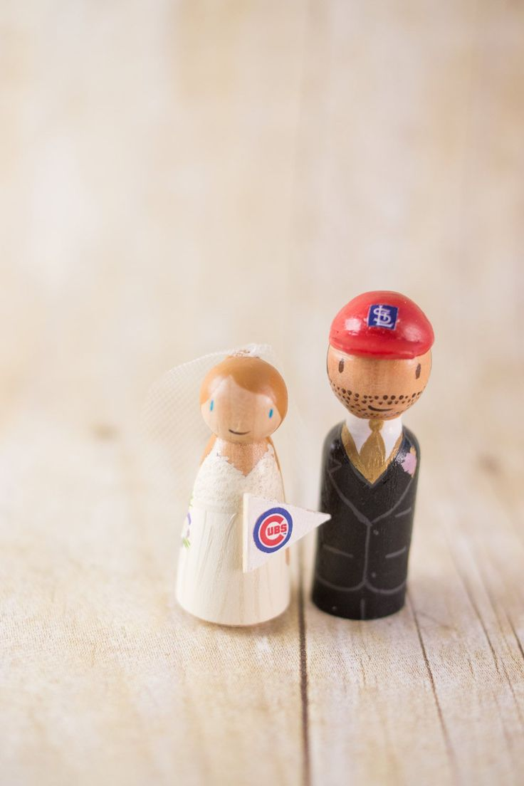 A custom cake topper is a cute way to tie in a love of sports for the bride or groom! By Lovebirds Goods.