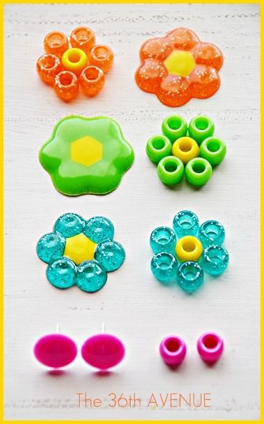 preheat your oven at 425 degrees F. Place a baking paper on top of a cookie sheet. Make the shapes placing your beads to your like. Have fun mixing colors and playing with different combinations. The flowers will take 10 minutes to melt. The earrings will take between 8 to 10 min.  Must have windows open.  Make sure kids are out of house while this is in oven.