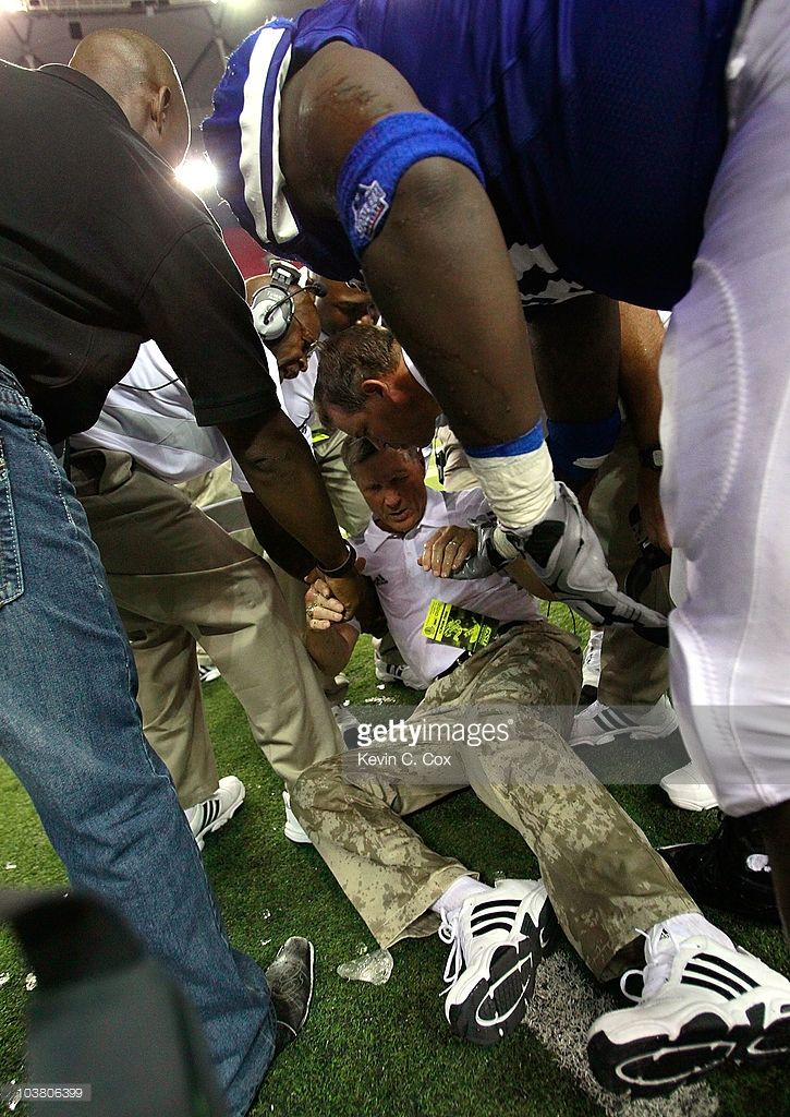 Head coach Bill Curry of the Georgia State Panthers is helped up off the field after getting hit in the head by a water cooler in the final minutes of their game against the Shorter Hawks at Georgia Dome on September 2, 2010 in Atlanta, Georgia.
