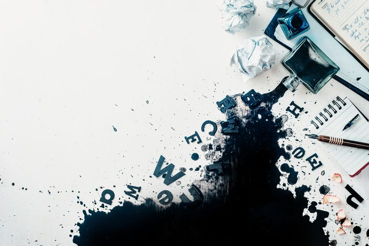 Header with spilled ink, crumpled paper, scattered letters, papers and notepads on a white wooden... - Header with spilled ink, crumpled paper, scattered letters, papers and notepads on a white wooden background. Creative writing concept. Flat lay with copy space. High key still life with an inkwell.
