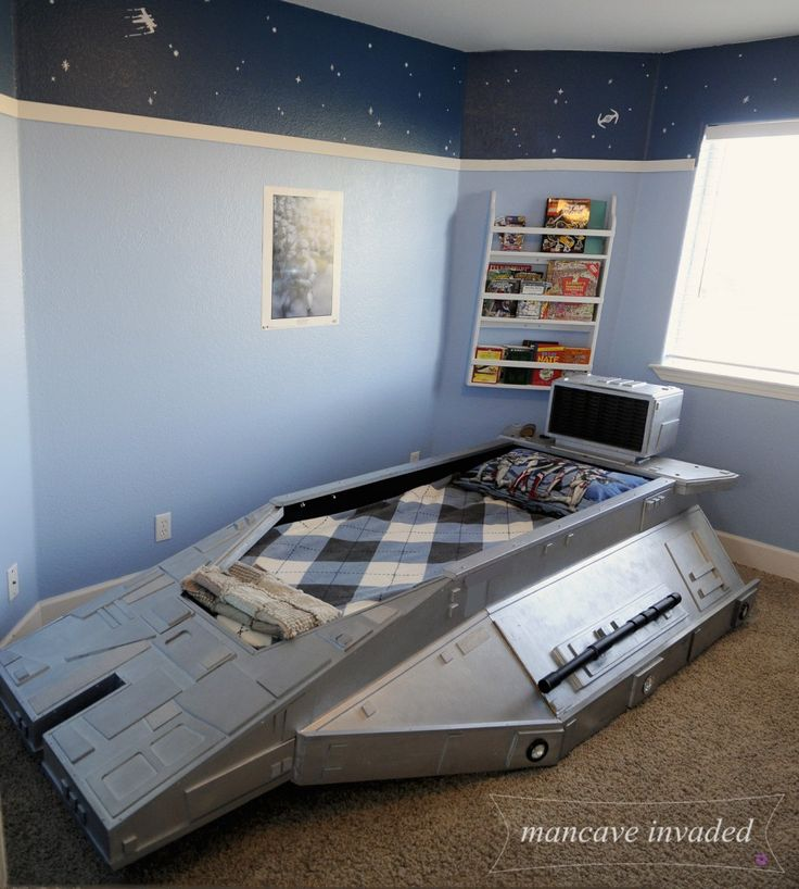 Star Wars Bed - Speeder Bed. Star Wars wall decals. Light blue on bottom, dark blue on top. Great boys bedroom. Awesome bed. www.mancaveinvaded.com mancave invaded